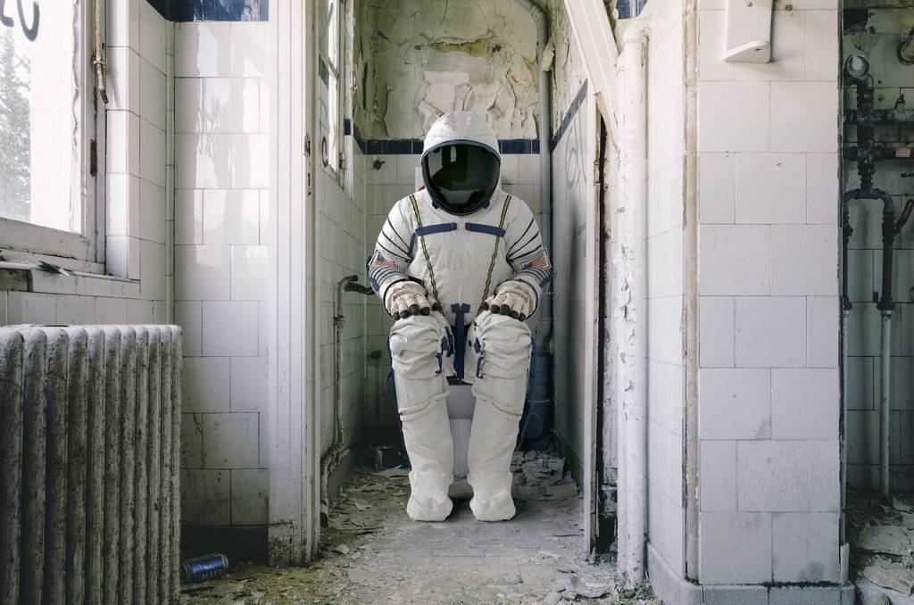 Astronauta en WC